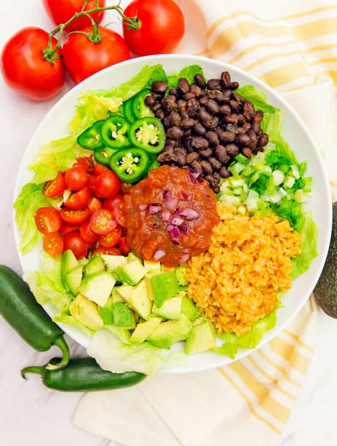 Salsa veggie bowl, veggie bowl, vegan, vegetarian, whole food plant based, gluten free, recipe, wfpb, healthy, oil free, no refined sugar, no oil, refined sugar free, lunch, dinner, easy, fast, quick, dinner party, entertaining, Spanish rice, rice, black beans, green onions, tomatoes, jalapeño, quick dinner, avocado, salsa dressing, fast dinner, dairy free, no dairy, Mexican, Southwestern