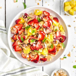 Tropical Fruit Salad, fruit salad, fruit, vegan fruit salad, plant based, vegan, vegetarian, whole food plant based, gluten free, recipe, wfpb, healthy, healthy vegan, oil free, no refined sugar, no oil, refined sugar free, dairy free, strawberry, banana, coconut, pineapple, easy recipe, fast recipe, sides, picnic, summer recipe, picnic recipe