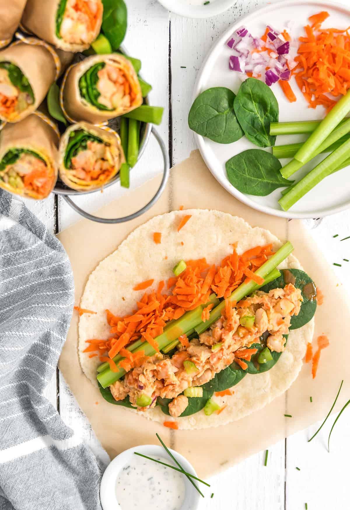 Vegan Buffalo Bean Wrap, Vegan Buffalo Bean Burrito, buffalo sauce, vegan wrap, vegan burrito, plant based, vegan, vegetarian, whole food plant based, gluten free, recipe, wfpb, healthy, healthy vegan, oil free, no refined sugar, no oil, refined sugar free, dairy free, lunch, easy recipe, fast recipe, sides, picnic, summer recipe, picnic recipe,