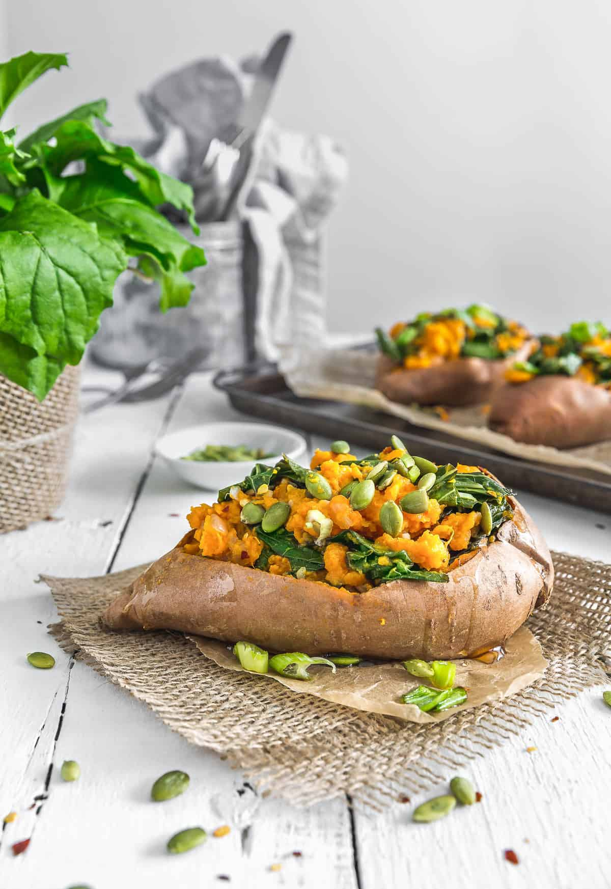 Collard Green Stuffed Sweet Potatoes, collard greens, sweet potatoes, vegan stuffed sweet potatoes, vegan dinner, vegan collard greens, vegan meals, plant based, vegan, vegetarian, whole food plant based, gluten free, recipe, wfpb, healthy, healthy vegan, oil free, no refined sugar, no oil, refined sugar free, dairy free, vegan lunch, dinner, lunch, easy recipe, potatoes, greens, summer