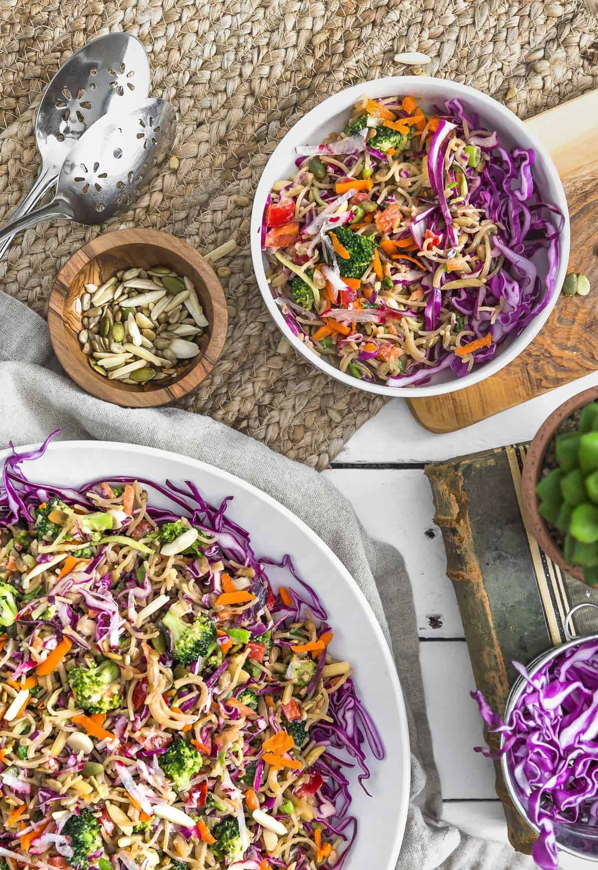 No Oil Broccoli Noodle Slaw, vegan salad, vegan slaw, vegan dinner, broccoli slaw, noodles, vegan noodles, plant based, vegan, vegetarian, whole food plant based, gluten free, recipe, wfpb, healthy, healthy vegan, oil free, no refined sugar, no oil, refined sugar free, dairy free, vegan dressing, vegan lunch, salad, dinner, lunch, easy recipe, dressing, broccoli, summer, picnic, party, entertaining