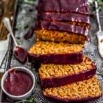 Close up of sliced Harvest Veggie Loaf with spiced cranberry sauce