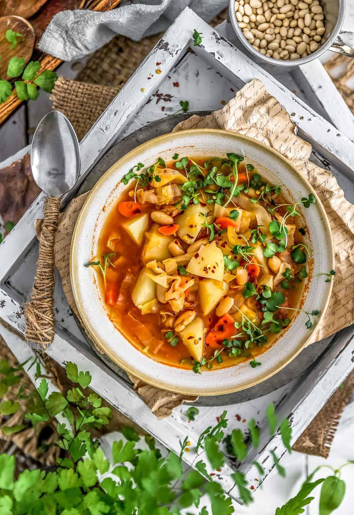 Flatlay of vegan Cabbage Potato Bean Soup