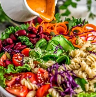 Pouring Oil Free Catalina Dressing on veggie bowl