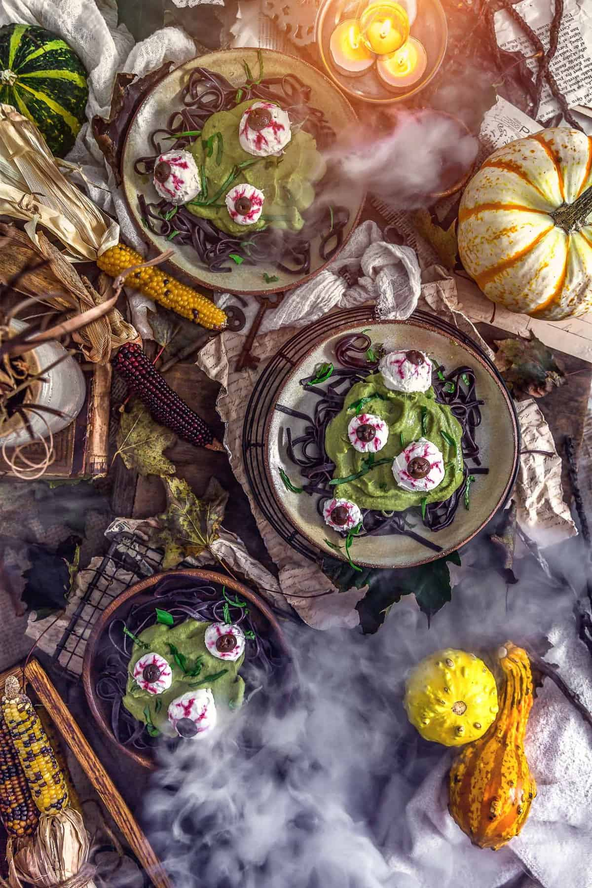 Tablescape of Spooky Spinach Halloween Pasta and smoke