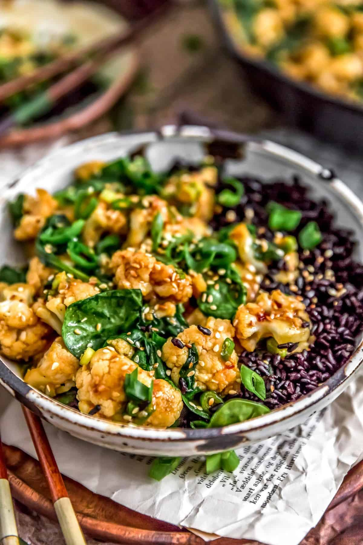 Close up of Vegan Korean BBQ Cauliflower in a bowl with rice