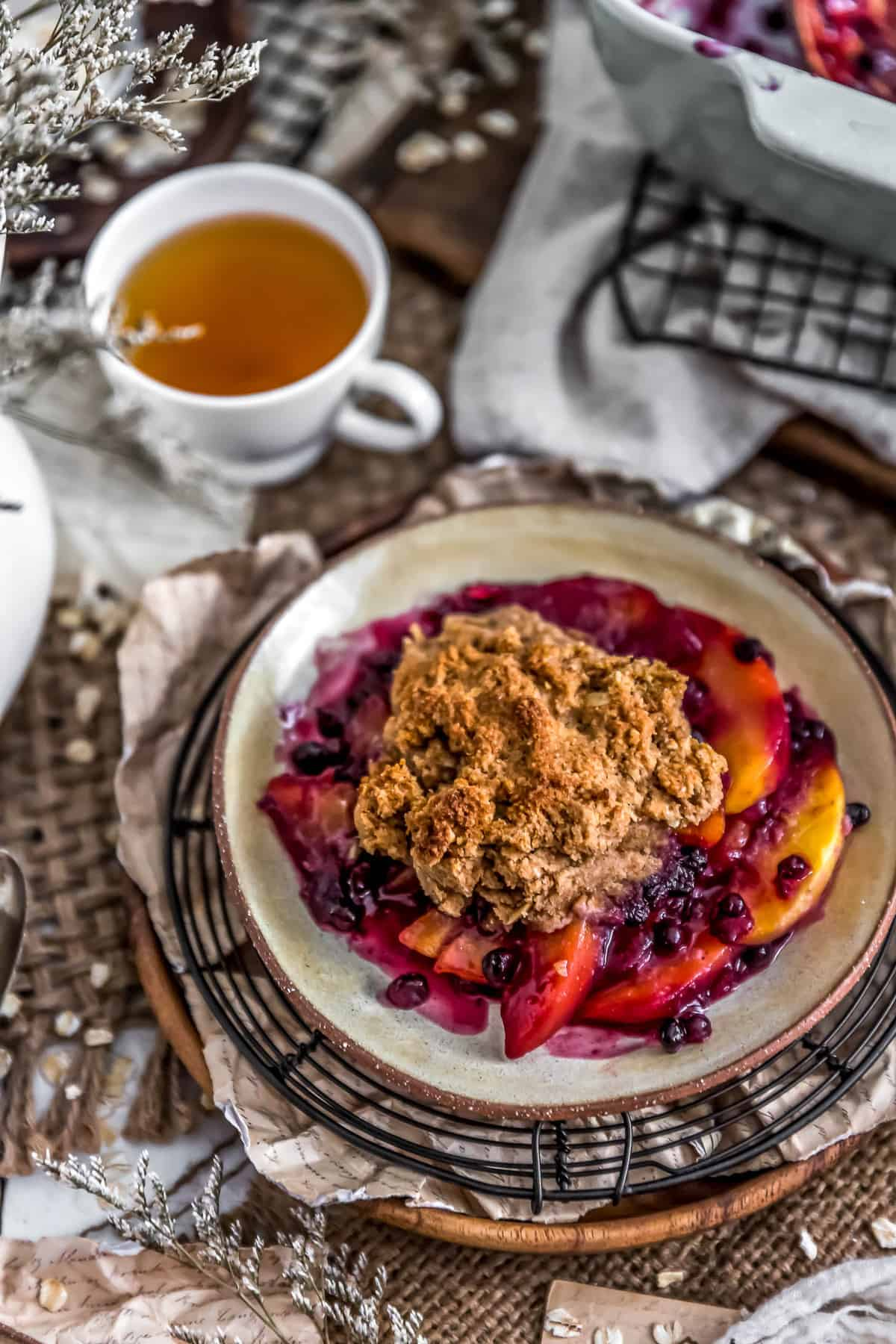 Tablescape of Peach Blueberry Biscuit Cobbler