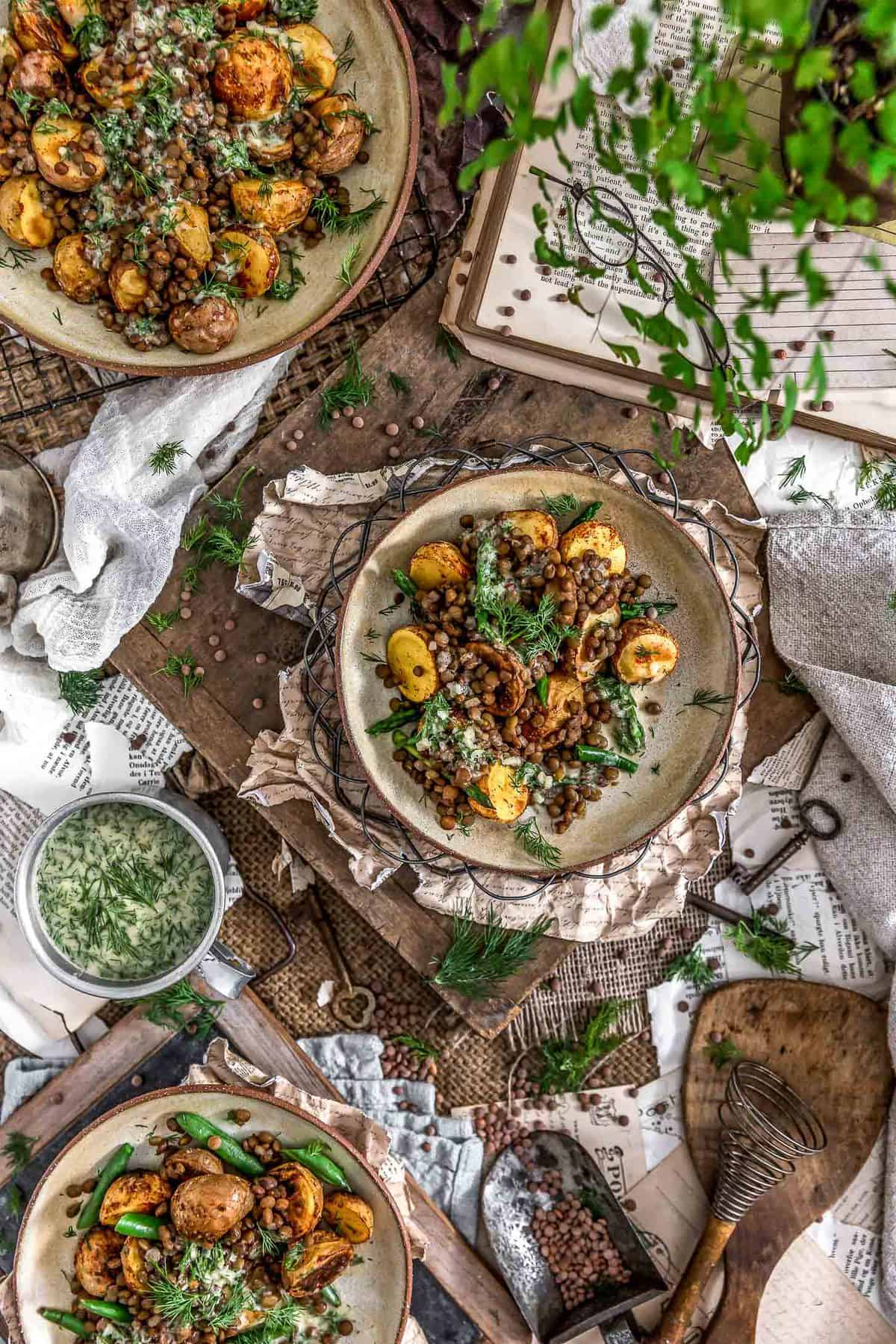 Tablescape of Roasted Potatoes with Seasoned Lentils and Dill Sauce