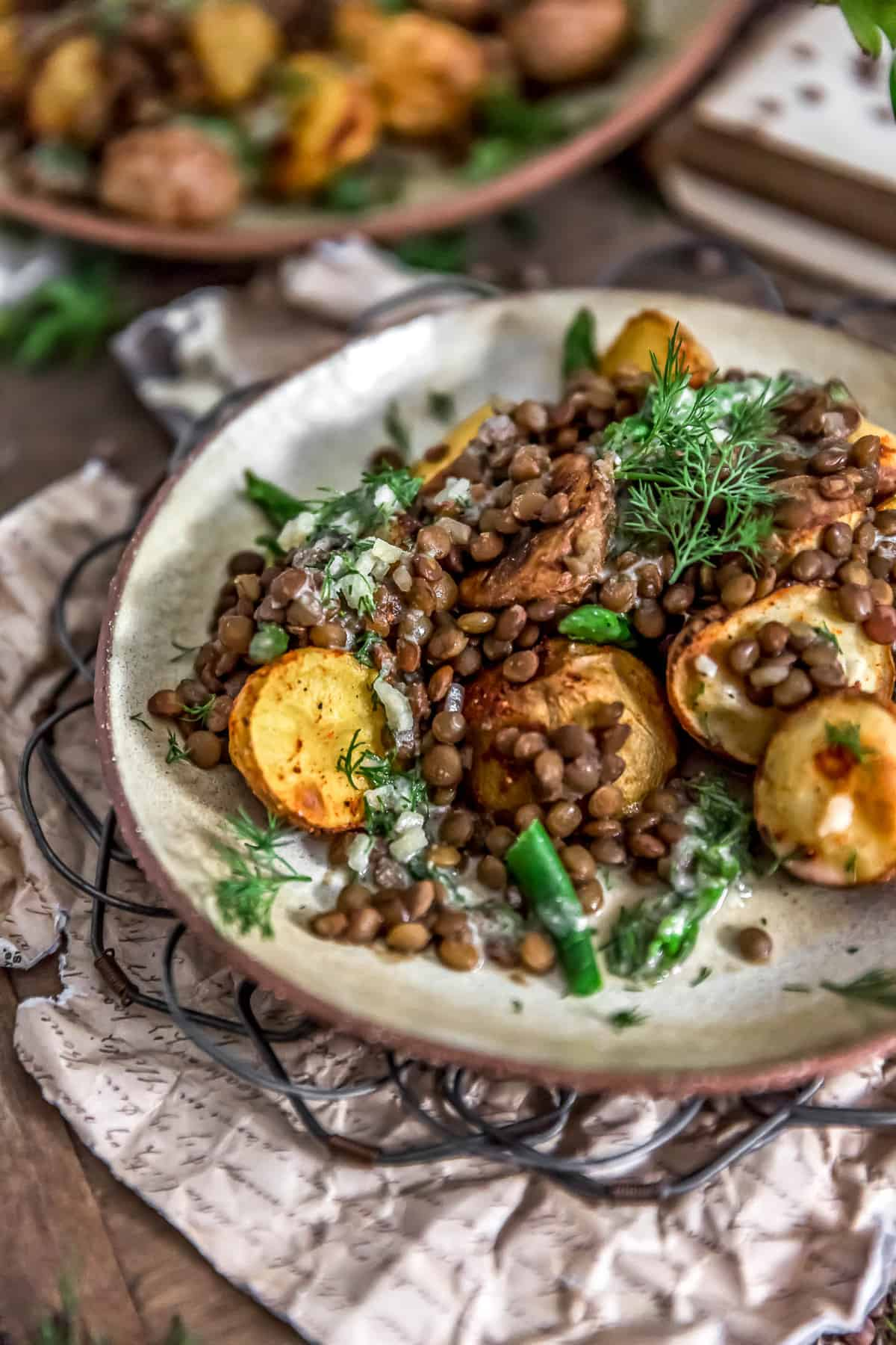 Sideview of Roasted Potatoes with Seasoned Lentils and Dill Sauce