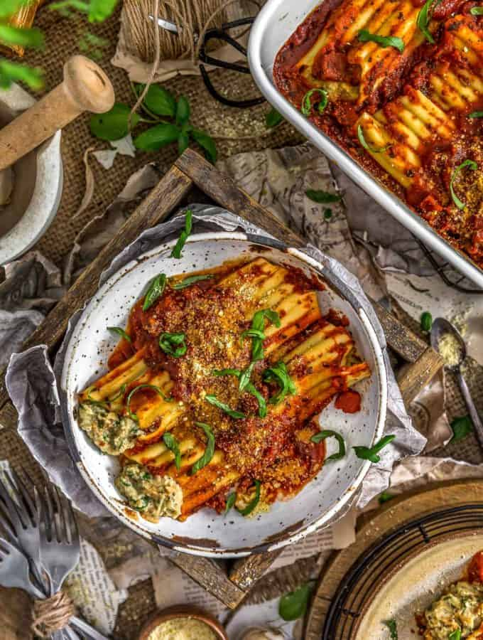 Tablescape of Vegan Manicotti Stuffed with Cauliflower Cream and Spinach