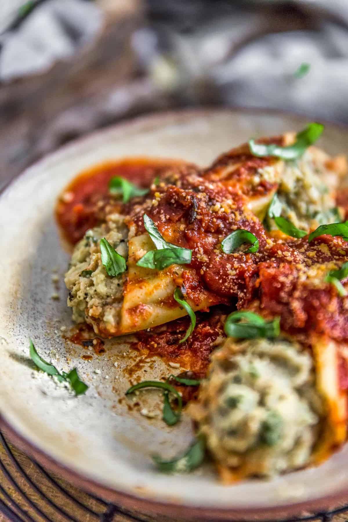Close up of Vegan Manicotti Stuffed with Cauliflower Cream and Spinach