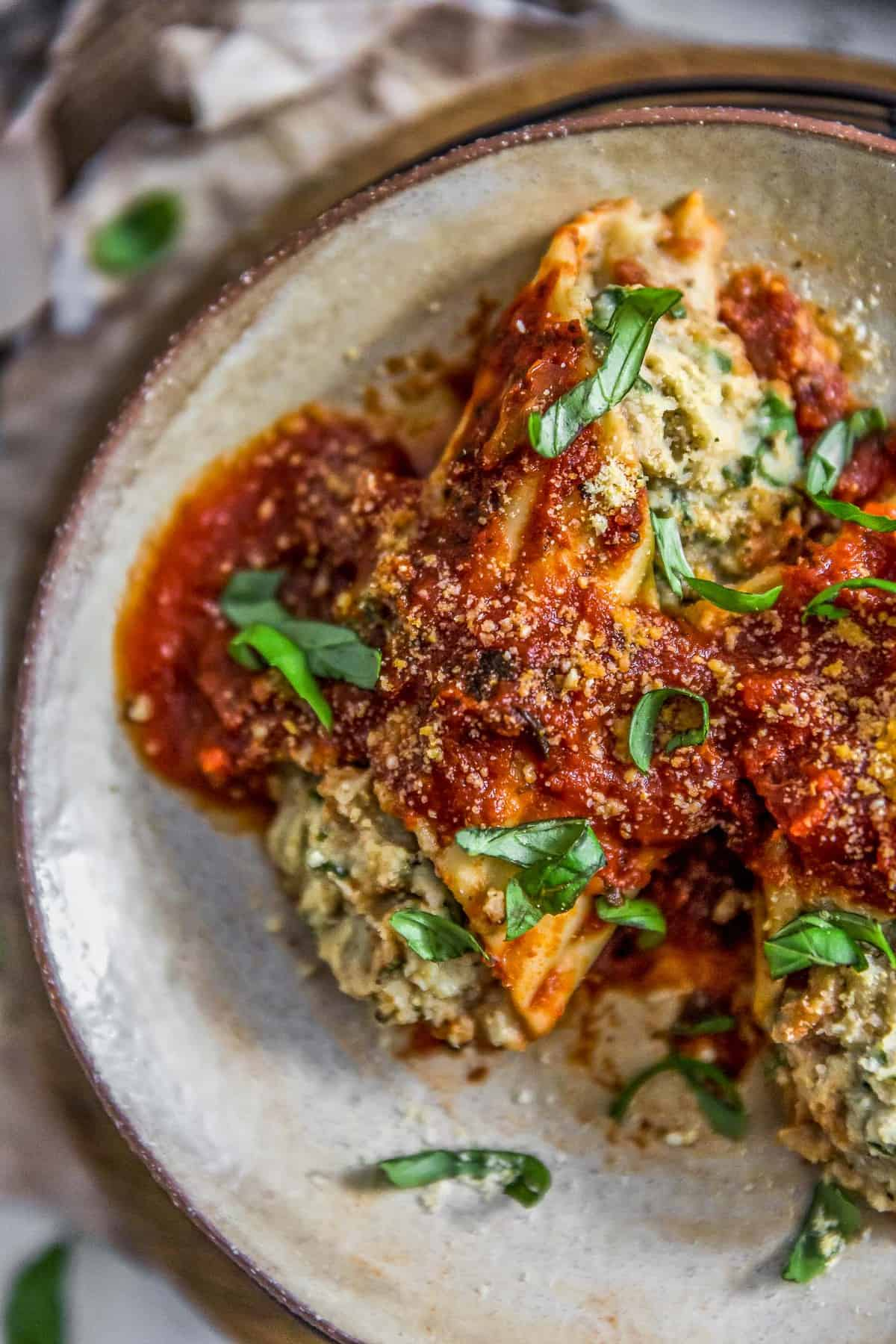 Plated Vegan Manicotti Stuffed with Cauliflower Cream and Spinach