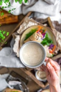 Vegan Tangy Honey Mustard Dressing in a cup