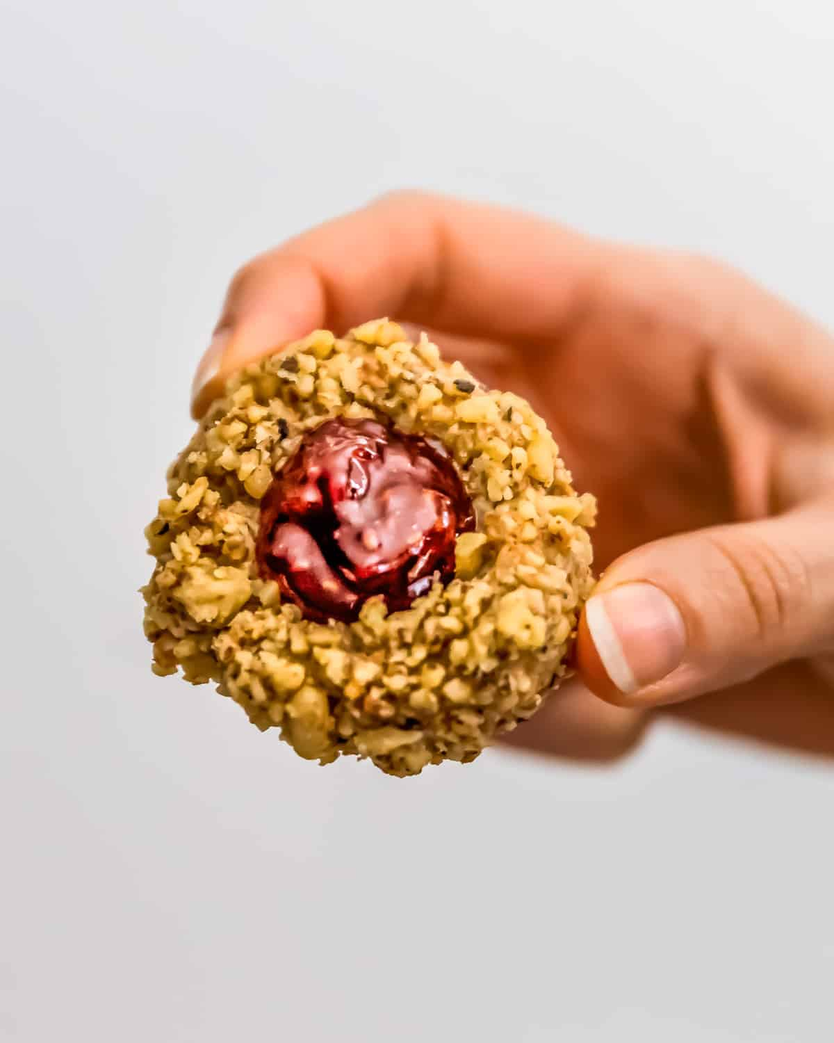 Holding a Vegan Thumbprint Cookie