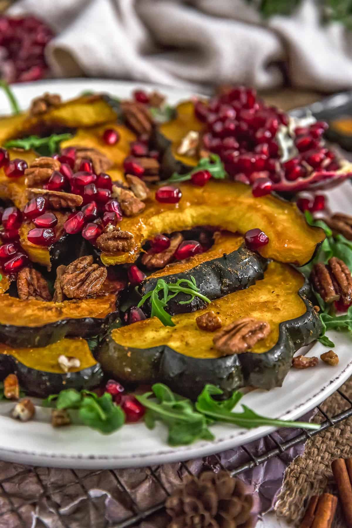 Plated Roasted Maple Glazed Acorn Squash with Cinnamon Pecans