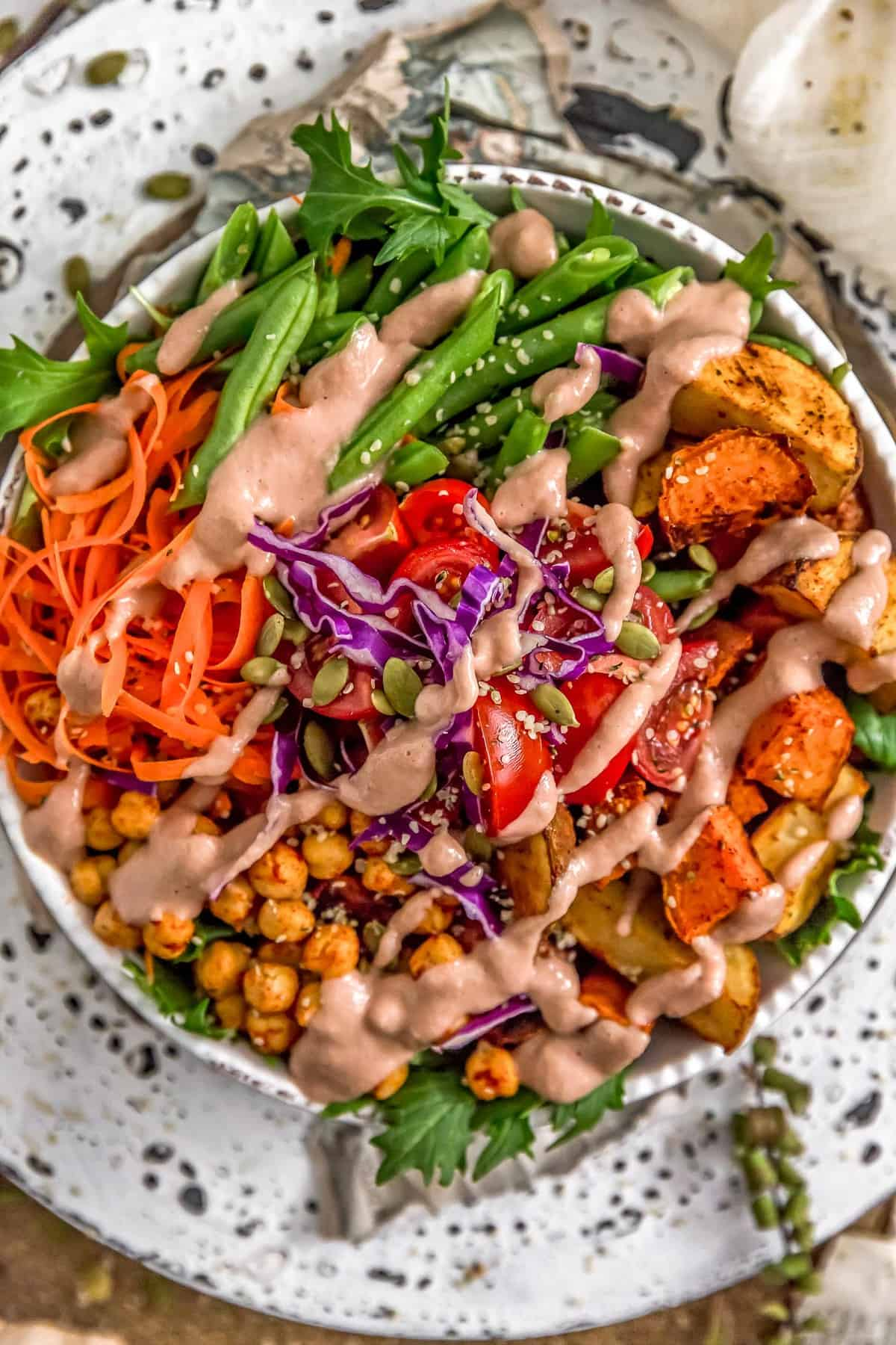 Warm Red Onion Dressing over a veggie bowl
