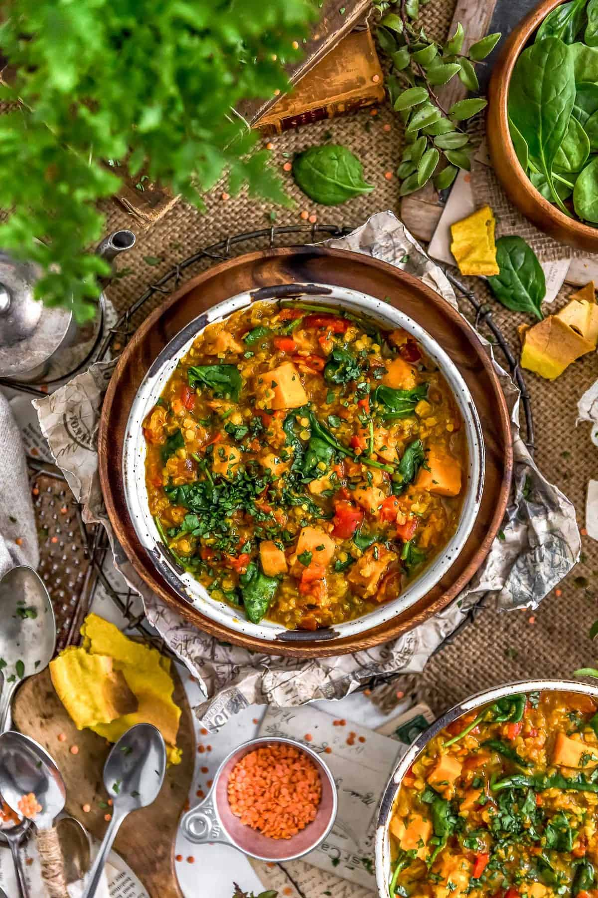 Tablescape of Curried Red Lentil and Sweet Potato Stew