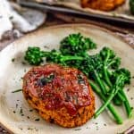 Plate of Mini Roasted Red Pepper Veggie Loaves with broccolini