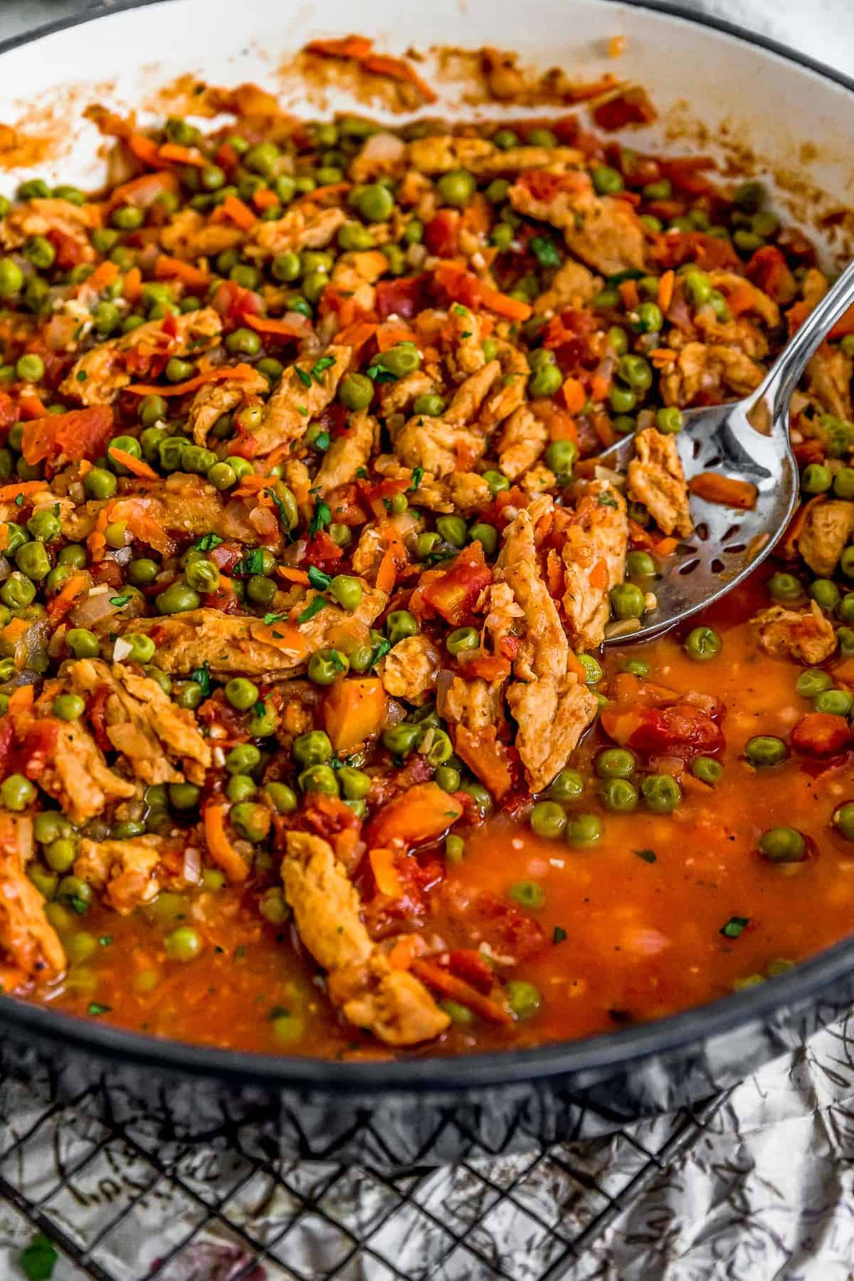 Spoon scooping Lebanese Soy Curls and Pea Stew (Bazilla)