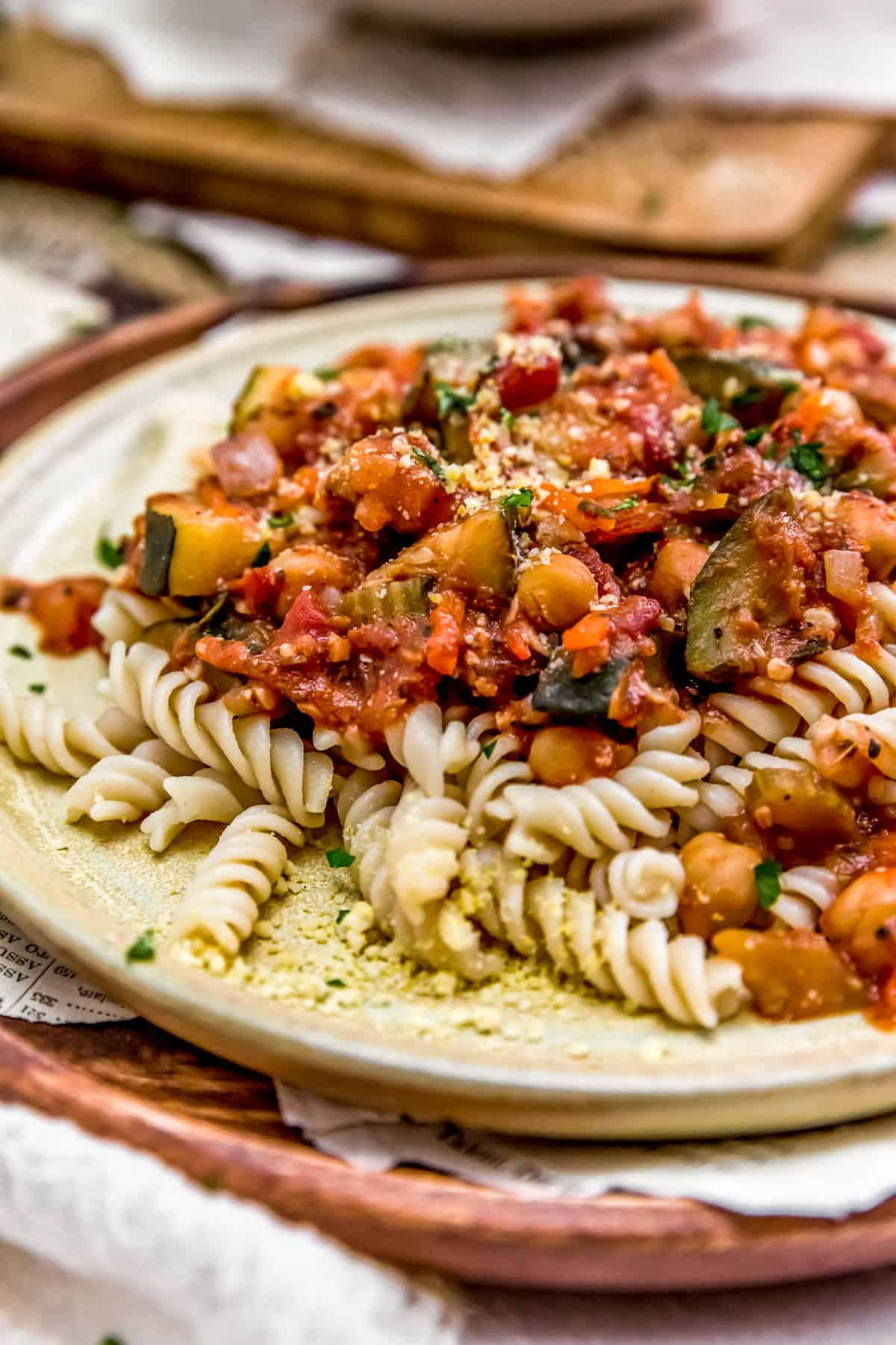 Close up of Italian Stewed Zucchini and Chickpeas over pasta