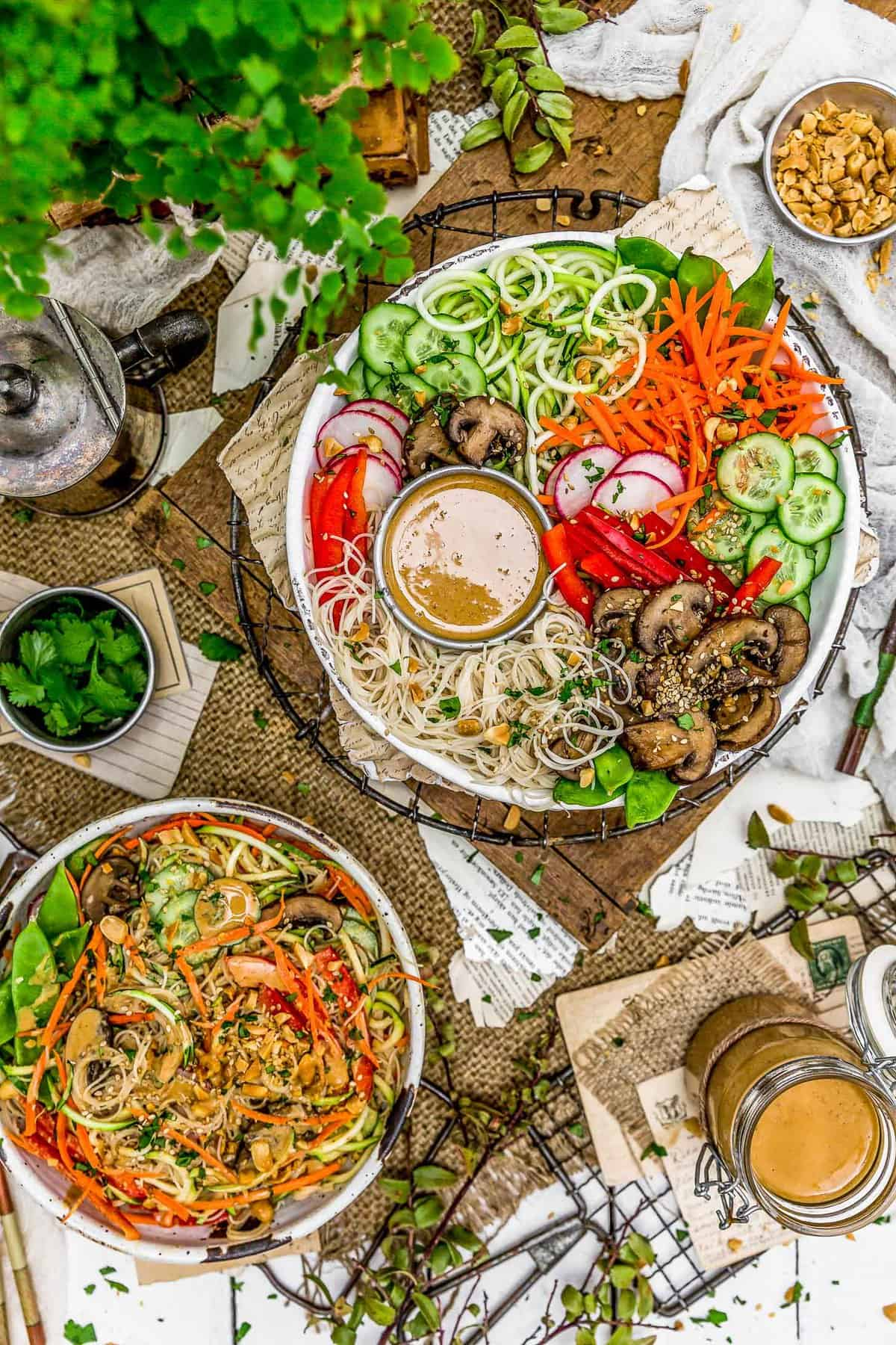 Tablescape of Spicy Peanut Dressing and veggie bowls