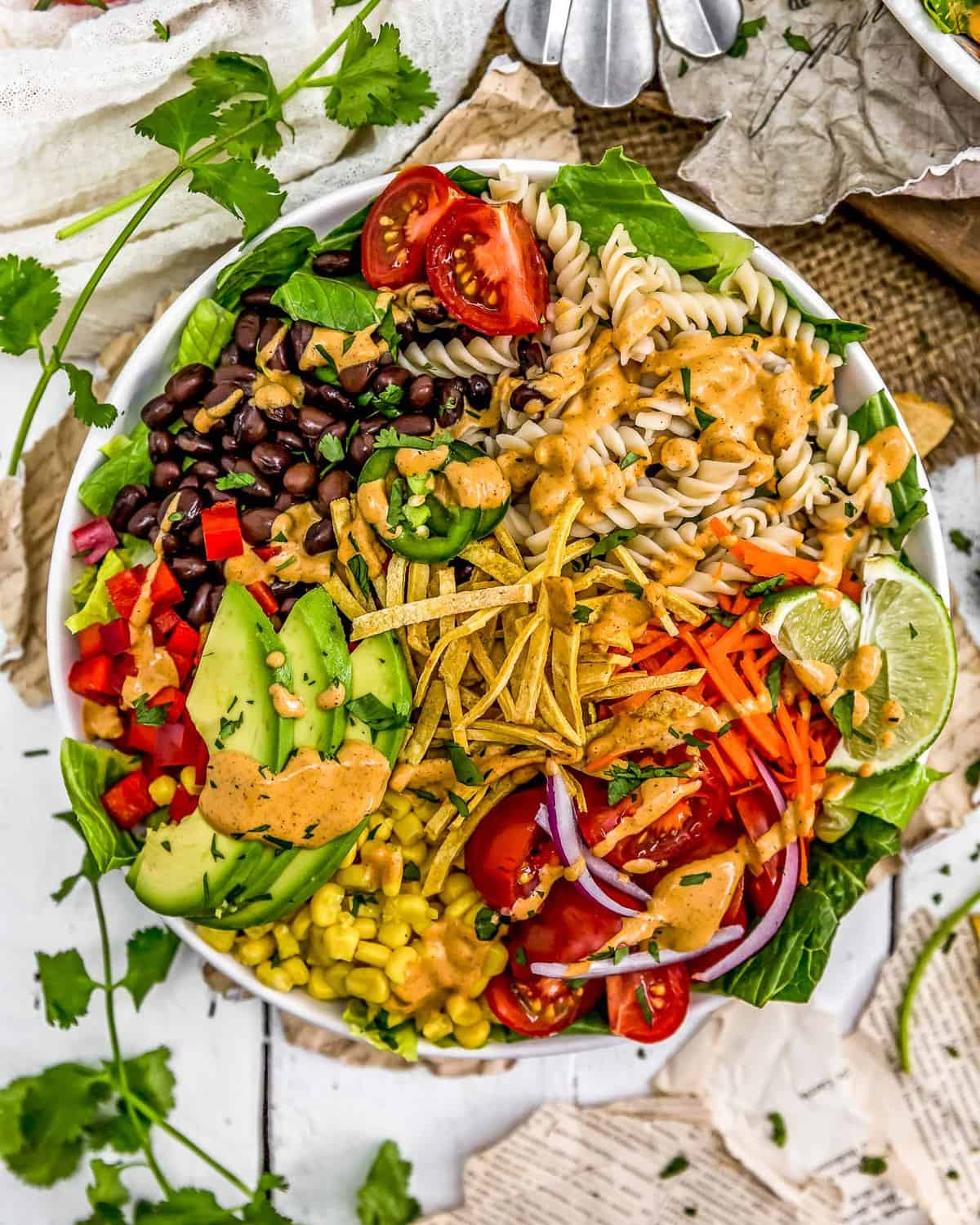 Vegan Creamy Taco Dressing drizzled on a veggie bowl
