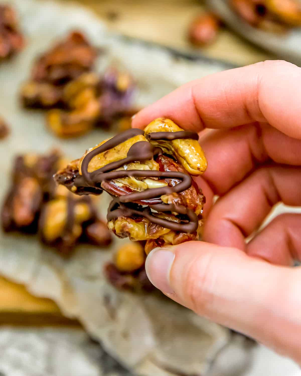 Holding Maple Glazed Nut Cluster