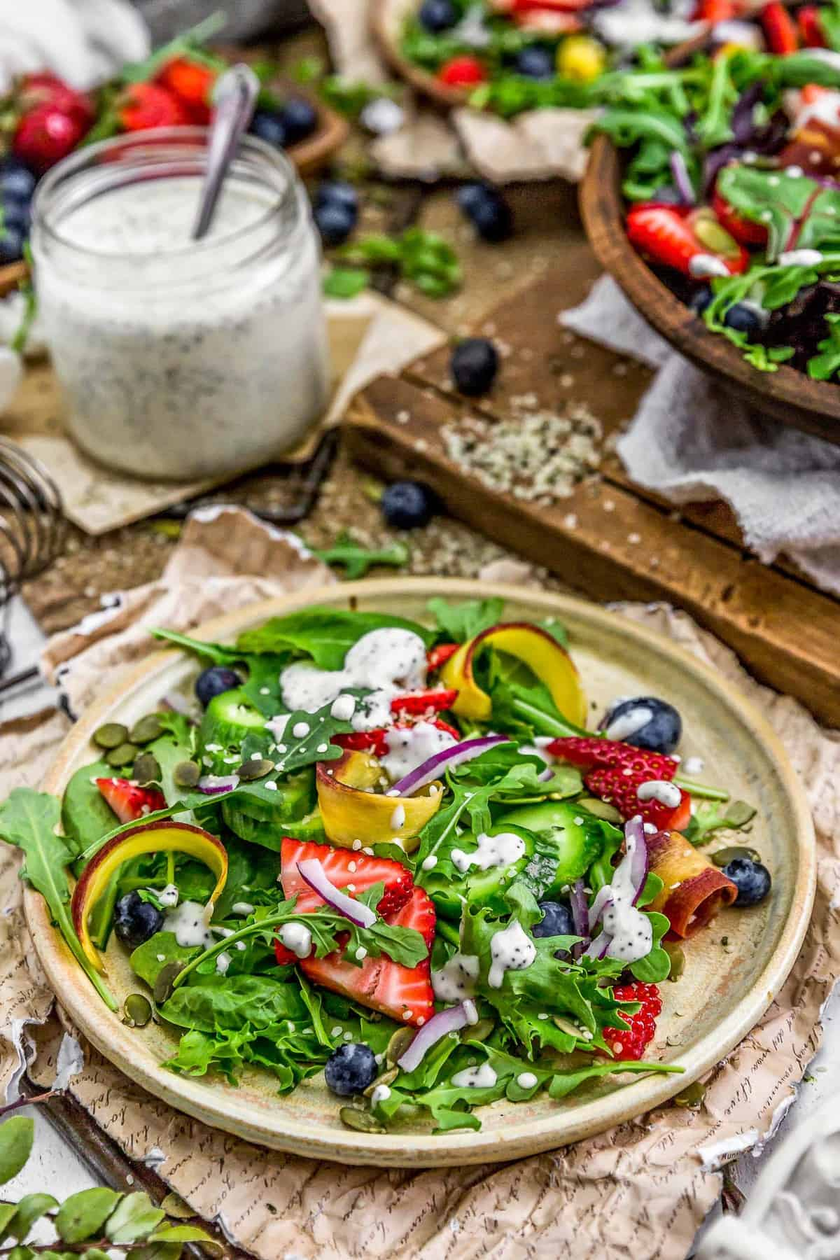 Tablescape of salad and Vegan Lemon Poppy Seed Dressing