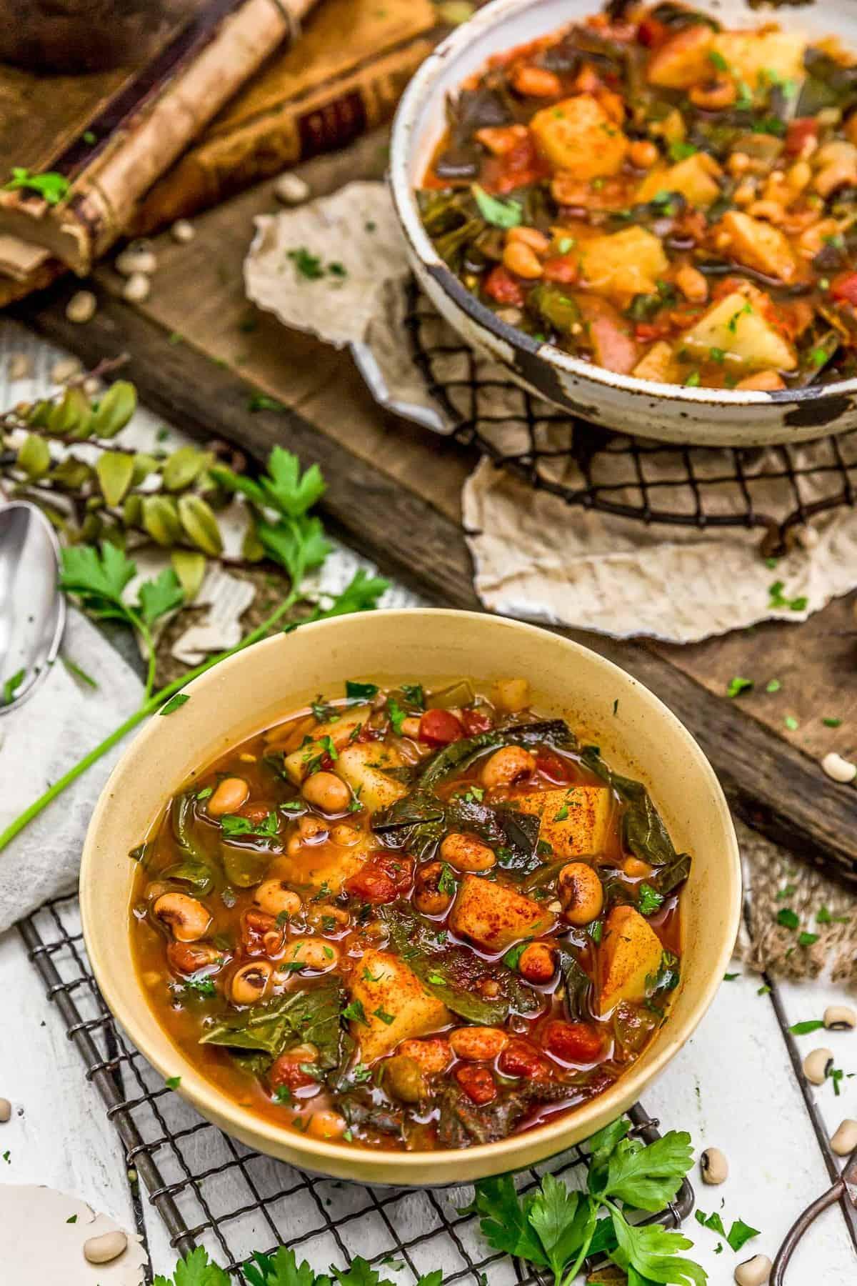 Two bowls of Southern Collard Green Potato Stew
