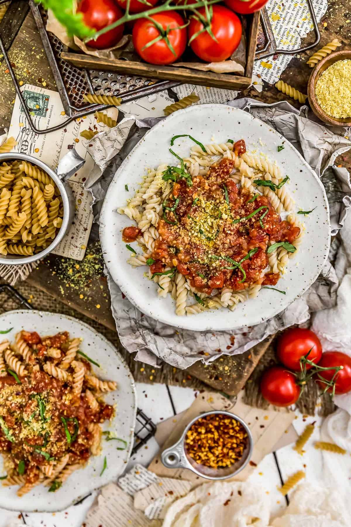 Tablescape of Spicy Arrabbiata Sauce with pasta