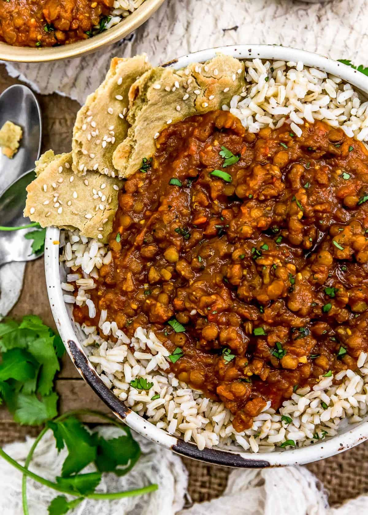 Creamy Lentil Curry over rice in a bowl