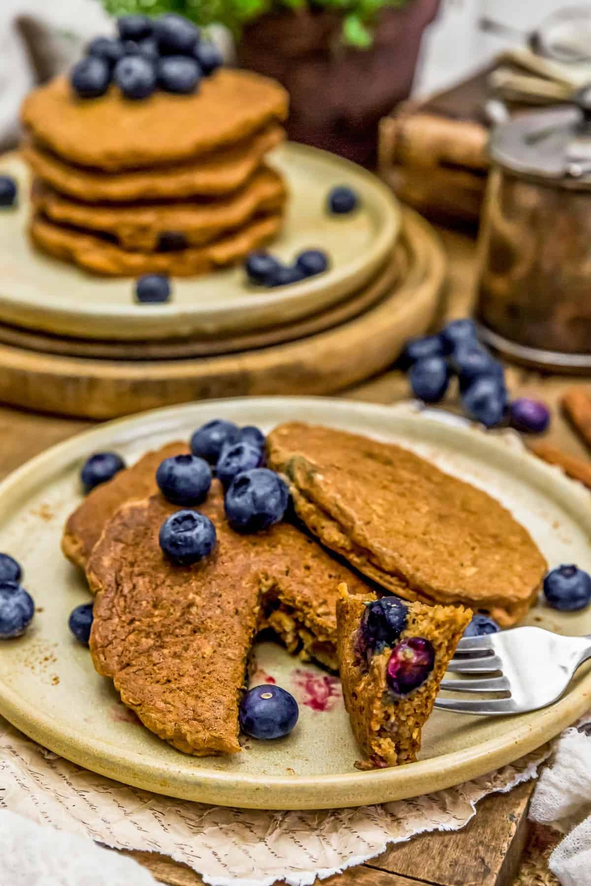 Plated Hearty Blueberry Oat Pancakes