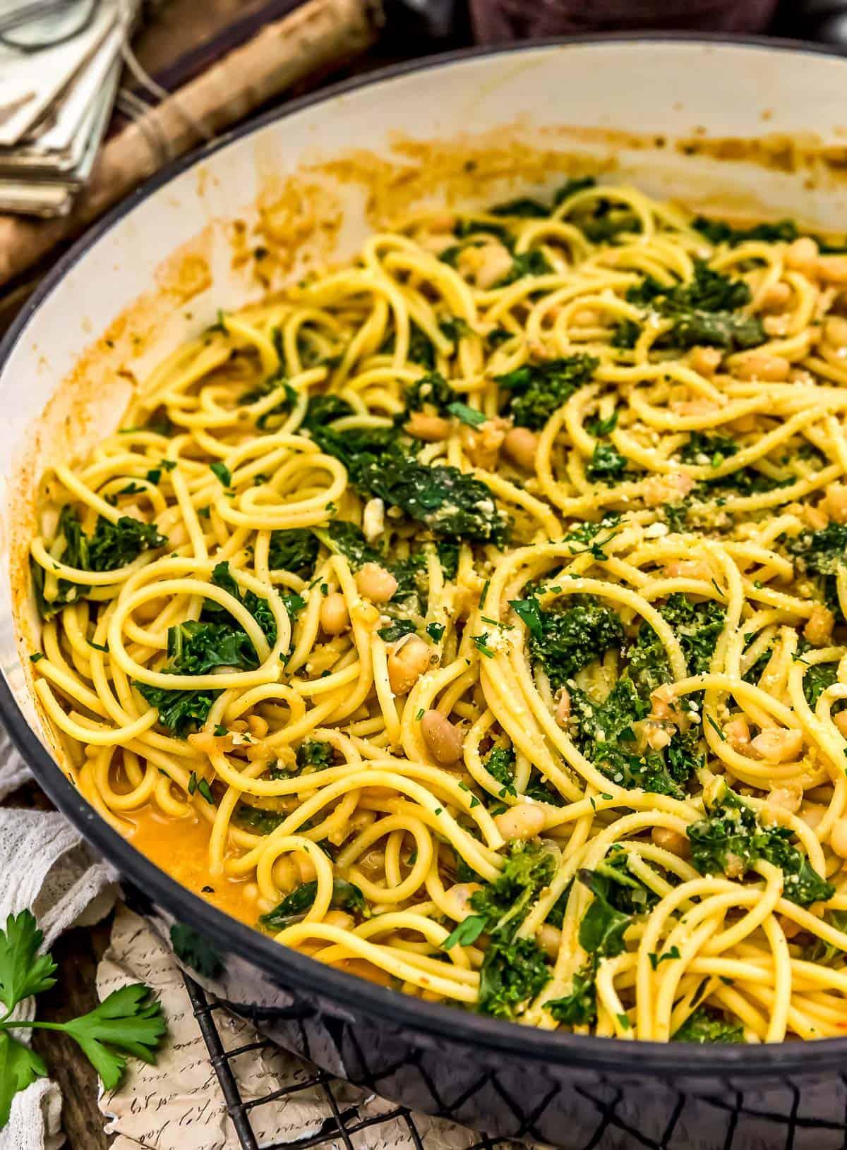 Close up skillet of Smoky Kale and Bean Pasta
