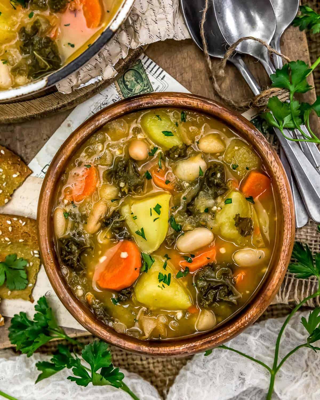 """Bowl of Vegan Potato """"Keilbasa"""" Kale Soup"""