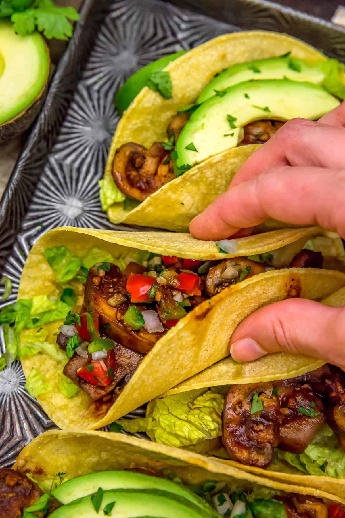 Eating Chipotle Mushroom Tacos