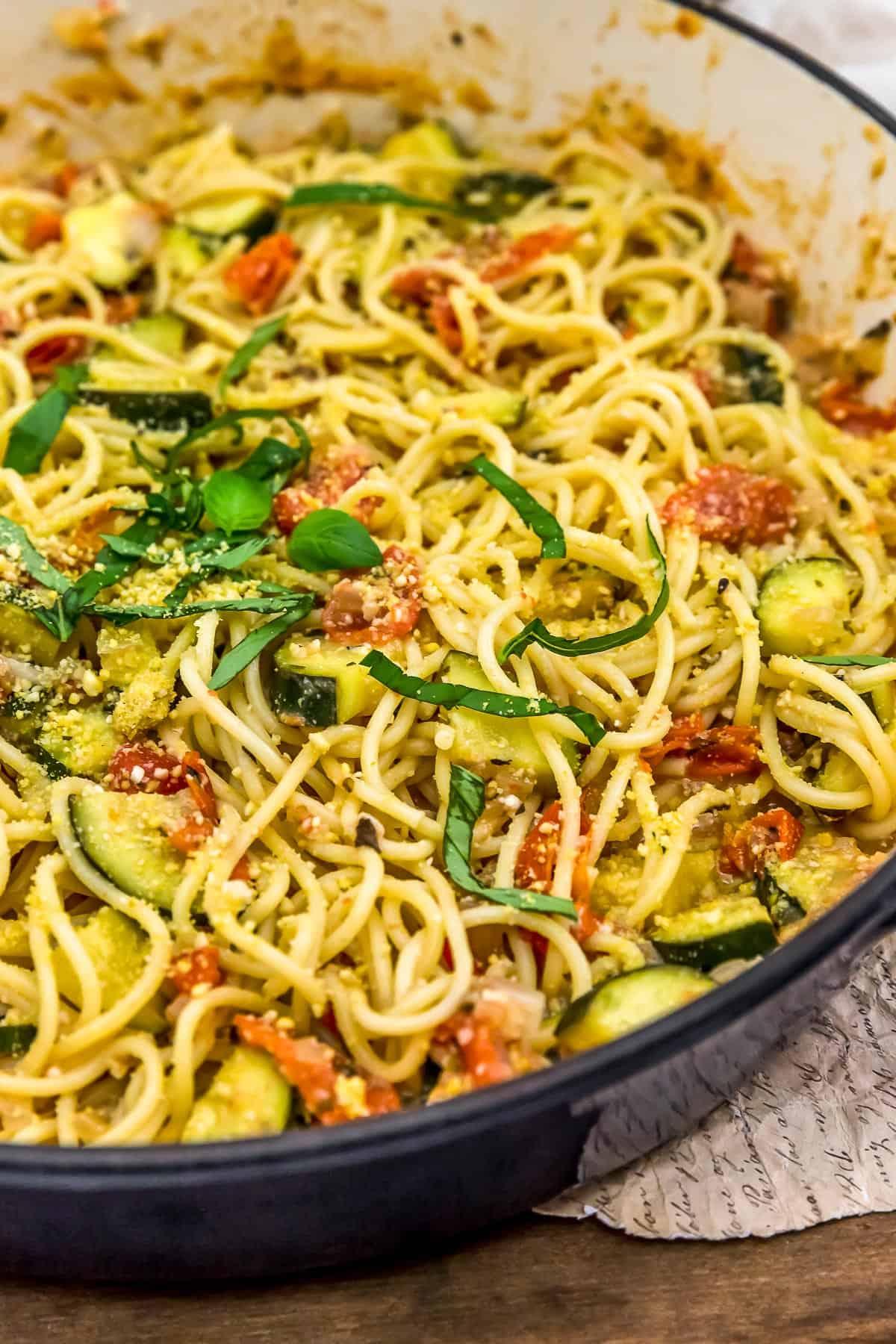 Close up skillet of Vegan Parmesan Zucchini and Tomato Pasta